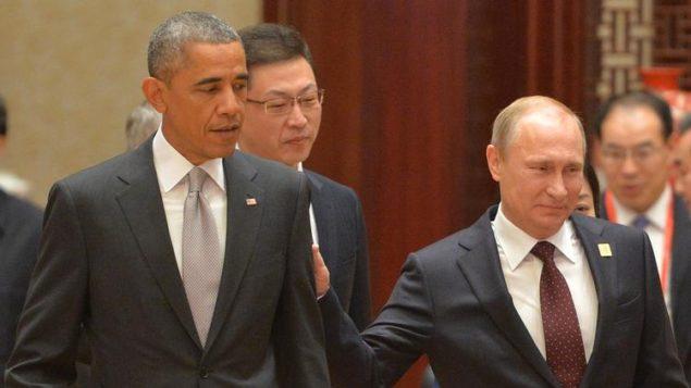 Кто важная персона теперь? Американский президент Барак Обама и президент России Владимир Путин в редком личном столкновении на саммите АТЭС в ноябре в Пекине. (Алексей Дружинин / AFP/Getty Images)