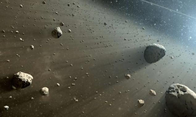 Зображення художником астероїдів і космічного пилу
